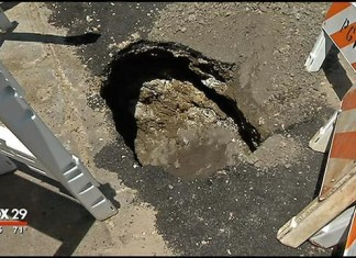 Philadelphia pizzeria sinkhole - Fox 29, Philadelphia pizzeria sinkhole: This small pothole is part of larger hole going under the walk and probably further - Fox 29