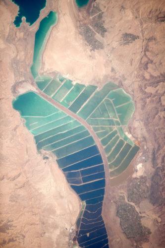 blue cyan salt pond dead sea, salt pond dead sea, salt pond at dead sea, magical salt pond at dead sea, The salt ponds at Dead Sea did not evolve too much between 2001 and 2012. Photo: NASA