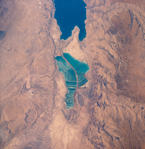 salt ponds at dead sea, aerial photo of dead sea salt ponds, dead sea salt ponds aerial picture, amazing places in the world, discover amazing places around the world, visit the blue cyan salt ponds at Dead Sea, visit the amazing salt ponds at Dead sea, unbelievable blue cyan salt ponds at Dead Sea, amazing places around the world: discover the dead sea salt ponds, dead sea salt ponds, dead sea salt onds, beautiful places around the world: dead sea salt ponds, magical dead sea salt ponds, amazing salt ponds at dead sea, The color of these salt ponds at Dead Sea is an amazing cyan blue. Photo taken in 1989. Photo: NASA