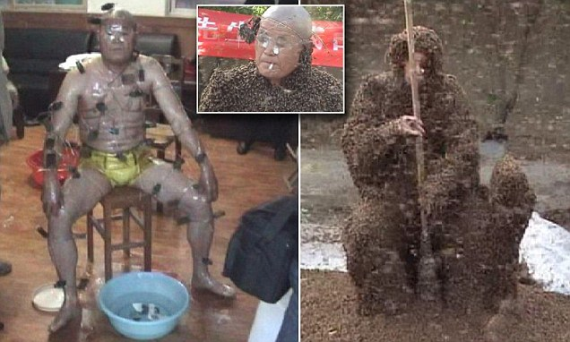 Beekeeper wears bee clothes of 326,000 bees, strangest world records, strangest world records: Chinese beekeeper sets new world record after being covered in 326,000 bees, crazy chinese covered with 360'000 bees, Chinese beekeeper sets new world record after being covered in 326,000 bees. Photo: Video, Chinese beekeeper sets new world record after being covered in 326,000 bees and uses warm water from bowl to ease pain of stings, A beekeeper has set a new world record for having the most bees on his body in Tan'an in northern China, record du monde un chinois s'habille avec 360'00 abeilles, les records les plus fous: chinois se transformeen ruche volante, chinois porte 360'ooo abeilles sur son corps, record incroyable, 360'000 abeilles sur le coprs d'un chinois, Man covered in bees breaks world record for most bees on body, new wolrd record june 2014, weirdest world record june 2014, weirdest world record 2014, un éleveur d'abeilles chinois couvre son corps avec 360000 abeilles étranges et dangereux record du monde, seltsames rekord: Chinesische Imker setzt neuen Weltrekord nachdem er in 326.000 Bienen bedeckt, imker in china bedeckt sich mit 360000 bienen, bienen rekord imker china juni 2014