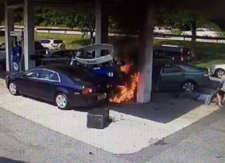 Heroic Gas Station Rescue Police Officer Saves A Man's Life After Gas Station Crash in White Plains (NY), amazing moment provided by the Westchester County Police, Senior State Police Investigator John Vescio is seen at right, pulling a driver from his burning Toyota after it has crashed into the pumps at the Hutchinson River Parkway Mobil gas station in White Plains June 3, 2014. The 69 year-old driver had a medical issue and was trapped inside the car. Westchester County Police, Fiery video: Injured hero 'just reacted' after gas station crash, amazing crash video in gas station in NY, NY gas station fire and rescue video, video gas station rescue by police officer, undercover police officer saves man's life after gas station crash june 2014, gas station crash june 2014 video, video gas station crash NY june 2014