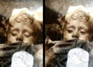 Rosalia Lombardo is the mysterious sleeping beauty mummy, sleeping beauty mummy, The Mystery of the blinking Rosalia Lombardo mummy sleeping beauty mummy, the blinking sleeping mummy mysterious debunked, mysterious mummy at Capuchin Catacombs in sicily, strange Rosalia Lombardo mummy at Capuchin Catacombs, the mystery of the blinking Rosalia Lombardo mummy, mysterious mummy in Sicily, strange mummy, Rosalia Lombardo mummy moves her eyelids several times a day, Rosalia Lombardo, Rosalia Lombardo mummy, Rosalia Lombardo mummy at catacombs beneath the Capuchin convent in Palermo in Sicily, mystery blinking mommy, mysterious mummy, mysterious Rosalia Lombardo mummy, the mystery behind the blinking mummy in Sicily, The Mystery of the blinking Rosalia Lombardo mummy debunked. Photo: Youtube video, Why Does This Mummy Appear To Open And Close Her Eyes?