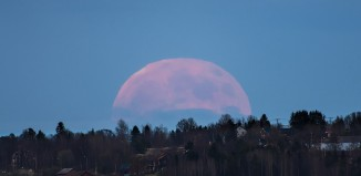 freaky friday the 13th june 2014: full moon and solar flare and full moon friday june the 13th june 2014, full moon june 2014, friday the 13th full moon june 2014, June's Full Moon (full phase on June 13, 0411 UT) is traditionally known as the Strawberry Moon or Rose Moon. Of course those names might also describe the appearance of this Full Moon, rising last month over the small Swedish village of Marieby. The Moon looks large in the image because the scene was captured with a long focal length lens from a place about 8 kilometers from the foreground houses. But just by eye a Full Moon rising, even on Friday the 13th, will appear to loom impossibly large near the horizon. That effect has long been recognized as the Moon Illusion. Unlike the magnification provided by a telescope or telephoto lens, the cause of the Moon illusion is still poorly understood and not explained by atmospheric optical effects, such as scattering and refraction, that produce the Moon's blushing color and ragged edge also seen in the photograph, Why Superstitious People Should Stay Home Friday, Sun Erupts with 3rd Huge Solar Flare in 2 Days, A full moon is rising on Friday the 13th -- the very same day a solar flare could send a shockwave to Earth's surface., superstition: A full moon is rising on Friday the 13th -- the very same day a solar flare could send a shockwave to Earth's surface.