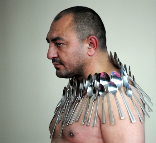 amazing human forces, amazing magnetic power, human magnetic power, amazing people this guy attracts metal, human magnetic power: Etibar elchyev attracts metal on his body, humn power: how etibar elchyev attracts spoons and metal with his body, healing system, inner power, magical human power, human are magic, this is amazing: etibar elchyev magnetic power, Magnetic power etibar elchyev, Magnetic power, etibar elchyev, The amazing magnetic power of Etibar Elchyev. Photo: Vano Shlamov / AFP - Getty Images