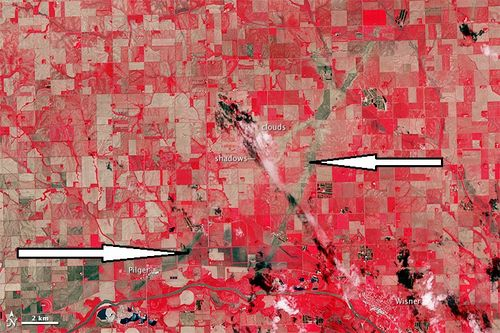 scars left after twin tornado in Pilger, scars in earth left by twin tornadoes in Pilger nebraska june 2014, pilger nebraska twin tornado june 2014, satellite image of scars in the earth of twin tornadoes in Pilger, pilger tornado twin tornadoes scars and path, satellite image showing path of twin tornado Nebraska satellite image, What Are These Two Mysterious Lines Appearing In This Satellite Image Of Nebraska? Image: NASA, nasa earth photo: path left by nebraska twin tornadoes in fields, path of destruction: path of twin tornadoes caught by nasa satellite, What Are These Two Mysterious Lines Appearing In This Satellite Image Of Nebraska? Image: NASA