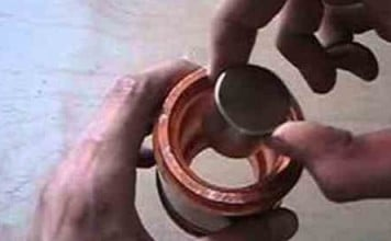 strange science: Neodymium magnet in FAT copper pipe, weird science: This Is What Happens When A Magnet Is Dropped Through A Copper Pipe, strange science experiements, most surprising science experiments, most amazing science experiments video, mind-blowing science experiments on video, best weird science videos, I fucking love science videos, I fucking love science best experiments video, Strange physical phenomenon: Lenz's Law explains why a magnet going down a fat copper pipe slows down and spins. Photo: Youtube video