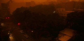 Tehran sandstorm june 2014, tehran sand storm june 2 2014, theran (IRAN) dust storm june 2 2014, video tehran dust storm june 2 2014, dust storm tehran june 2 2014 video, apocalyptic dust storm engulfs tehran june 2 2014, killer sand storm engulfs tehran june 2 214 video, video of tehran dust storm june 2 2014, Tehran killer sandstorm June 2 2014, Apocalyptic and killer dust storm in Tehran (IRAN) on June 2, 2014. Photo: Ebrahim Noroozi, A view of Tehran, Iran, Monday, June 2, 2014, while a flash dust storm hits the Iranian capital. Iran's state TV is reporting that at least two people have been killed and 30 others injured after a heavy dust storm hit the capital Tehran with a speed of 110 kilometers per hour. (AP Photo/Ebrahim Noroozi)