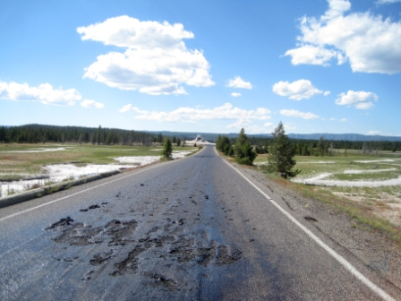road closed due to melting in Yellowstone, yellowstone supervolcano melts road in park, yellowstone oddity, strange things in yellowstone national park, road melts in yellowstone national park , thermal heating melts road in Yellowstone national park, why are road in yellowstone melting, yellowstone national park roads are melting because of thermal heating, yellowstone supervolcano melts roads in yellowstone national park, yeloowstone volcano melts road in national park, road melted by yellowstone volcano july 10 2014, Firehole Lake Drive Temporarily Closed in Yellowstone on July 10 2014, scenic road in yellowstone national park closed, Underground heat from the park's super volcano combined with the warm summer sun have melted a section of a road in Yellowstone National Park, forcing its temporary closure on July 10 2014. Photo: NPS