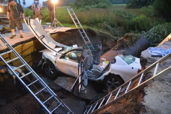 sinkhole, cave-in, sinkhole report, sinkhole report: sinkhole swallows car in Kane county june 2014, huge sinkhole swallows two cars in kane county illinois july 2014, sinkhole swallows car kane county, cars swallowed by sinkhole in Kane county, illinois sinkhole swallows two cars in july 2014, july 2014 sinkhole illinois, cars swallowed by sinkhole in Kane county illinois july 2014, Two cars were swallowed by a large sinkhole in Kane County (ILLINOIS) on July 1 2014. Photo: Radioman911.com