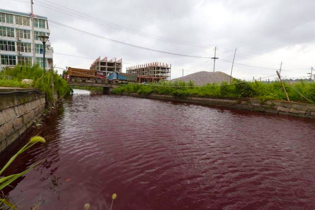 chinese river turns blood red july 25 2014, chinese river turns blood red july 25 2014 photo, video chinese river turns blood red july 25 2014, blood red river china july 2014, extreme pollution: blood red river in china july 2014, china rivers blood red july 2014 photo, River in China mysteriously turns blood-red overnight, Mystery: Chinese River Turns Blood Red Overnight, Mystery: Chinese river turns blood red overnight on July 25 2014! Locals are baffled as nobody knows the cause of this strange and mysterious event yet, MYSTERIOUS BLOOD RED RIVER IN CHINA OVERNIGHT, How did this Chinese river turn crimson red blood? Locals and scientists are baffled!