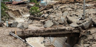 Typhoon Neoguri: 12-year-old boy killed by landslide in Japan – video report, landslide killes boy during neoguri typhoon in Japan, extreme landslide video, killer landslide japan july 2014, typhoon neoguri killer landslide nagiso july 2014, video nagiso landslide july 2014, extreme weather: nagiso's landslide during neoguri typhoon, killer landslide in japan video, amazing landslide video japan july 2014, landslide japan neoguri typhoon video, Typhoon neoguri landslide damage in Nagiso, Rock blocks in Nagiso, Japan, after killer landslide swept through the city during Typhoon Neoguri on July 10 2014. Photo: The Guardian video
