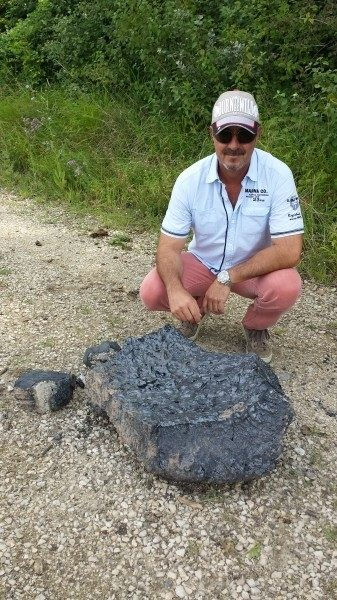 This is not a meteorite! A chunk discovered in the Emme after a steel plant explosion in Switzerland on July 12 2014. Photo: Marcel Pesse, flying glowing rock after steel plant explosion Switzerland, flying rocks steel plant explosion july 2014, meteorite like rocks after explosion steel plant july 2014, steel plant explosion july 2014, swiss steel plant explosion july 2014, loud booms switzerland july 2014, flying glowing rocks after explosion july 2014, explosion, loud booms, blast, switzerland july 2014, flsteel plant explosion, explosion, steel plant explosion, Switzerland, mystery boom, mystery boom and rumbling, loud booms during steel plant explosion in Switzerland july 2014, huge meteorite-like chunks of rock created by steel plant explosion in Switzerland july 2014, steel plant explosion triggers giant flying rock in Switzerland, giant flying orbs fly over Switzerland after steel plant explosion, meteorite like rocks fly over swiss city after steel plant explosion