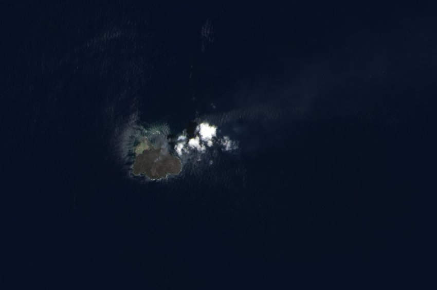 Nishino-shima, niijima, Nishino-shima photo, niijima photo, evolution of new volcanic island in Japan (photo), The new island Nishino-shima as seen from space in July 2014. Photo: NASA, new volcanic island Japan Nishino-shima, More than 6 months after it broke the surface of the Pacific Ocean, Nishino-shima (once called Niijima) continues to grow. The new land surface is now several times larger than original Nishino-shima, which formed in 1973. The islets merged in December 2013. This natural-color image was collected by the Operational Land Imager (OLI) on Landsat 8 on July 4, 2014. It shows a plume of ash, steam, and other volcanic gases streaming from a crater in the center of the island., geology oddity, volcanic island, new volcanic island, earth oddity, strange things around the world, volcano activity creates new island off Japan, Japan new island volcano, japan new volcanic island,