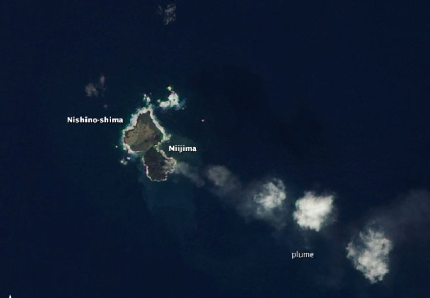 new volcanic island japan, evolution of new volcanic island japan, The two islands merging in December 2013. This new volcanic island resulted from magmatic activity along the western edge of the Pacific 'Ring of Fire'. Photo: NASA, Nishino-shima, niijima, Nishino-shima photo, niijima photo, evolution of new volcanic island in Japan (photo), The new island Nishino-shima as seen from space in July 2014. Photo: NASA, new volcanic island Japan Nishino-shima, More than 6 months after it broke the surface of the Pacific Ocean, Nishino-shima (once called Niijima) continues to grow. The new land surface is now several times larger than original Nishino-shima, which formed in 1973. The islets merged in December 2013. This natural-color image was collected by the Operational Land Imager (OLI) on Landsat 8 on July 4, 2014. It shows a plume of ash, steam, and other volcanic gases streaming from a crater in the center of the island., geology oddity, volcanic island, new volcanic island, earth oddity, strange things around the world, volcano activity creates new island off Japan, Japan new island volcano, japan new volcanic island,