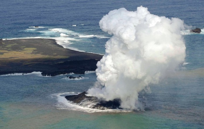 New volcanic island off Japan coast Niijima, Geological oddity: Smoke from an erupting undersea volcano forms a new island off the coast of Nishinoshima in the southern Ogasawara chain of islands.