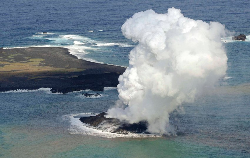 New volcanic island off Japan coast Niijima, Geological oddity: Smoke from an erupting undersea volcano forms a new island off the coast of Nishinoshima in the southern Ogasawara chain of islands, Nishino-shima, niijima, Nishino-shima photo, niijima photo, evolution of new volcanic island in Japan (photo), The new island Nishino-shima as seen from space in July 2014. Photo: NASA, new volcanic island Japan Nishino-shima, More than 6 months after it broke the surface of the Pacific Ocean, Nishino-shima (once called Niijima) continues to grow. The new land surface is now several times larger than original Nishino-shima, which formed in 1973. The islets merged in December 2013. This natural-color image was collected by the Operational Land Imager (OLI) on Landsat 8 on July 4, 2014. It shows a plume of ash, steam, and other volcanic gases streaming from a crater in the center of the island., geology oddity, volcanic island, new volcanic island, earth oddity, strange things around the world, volcano activity creates new island off Japan, Japan new island volcano, japan new volcanic island,