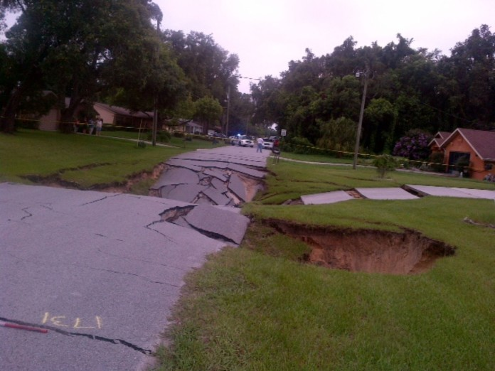 This monster sinkhole in Spring Hill, Florida measures now 40 x 40 yards long and is 30 feet deep. Amazing!, sinkhole, sinkhole formation, us sinkhole july 2014, florida sinkhole july 2014, spring hill giant sinkhole july 19 2014, giant sinkhole spring hill photo, photo of giant sinkhole in spring hill florida july 2014, video giant sinkhole spring hill july 2014, florida sinkhole florida july 2014, new sinkhole florida july 2014, sinkhole florida july 2014, giant sinkhole florida july 2014, giant sinkhole Spring Hill florida