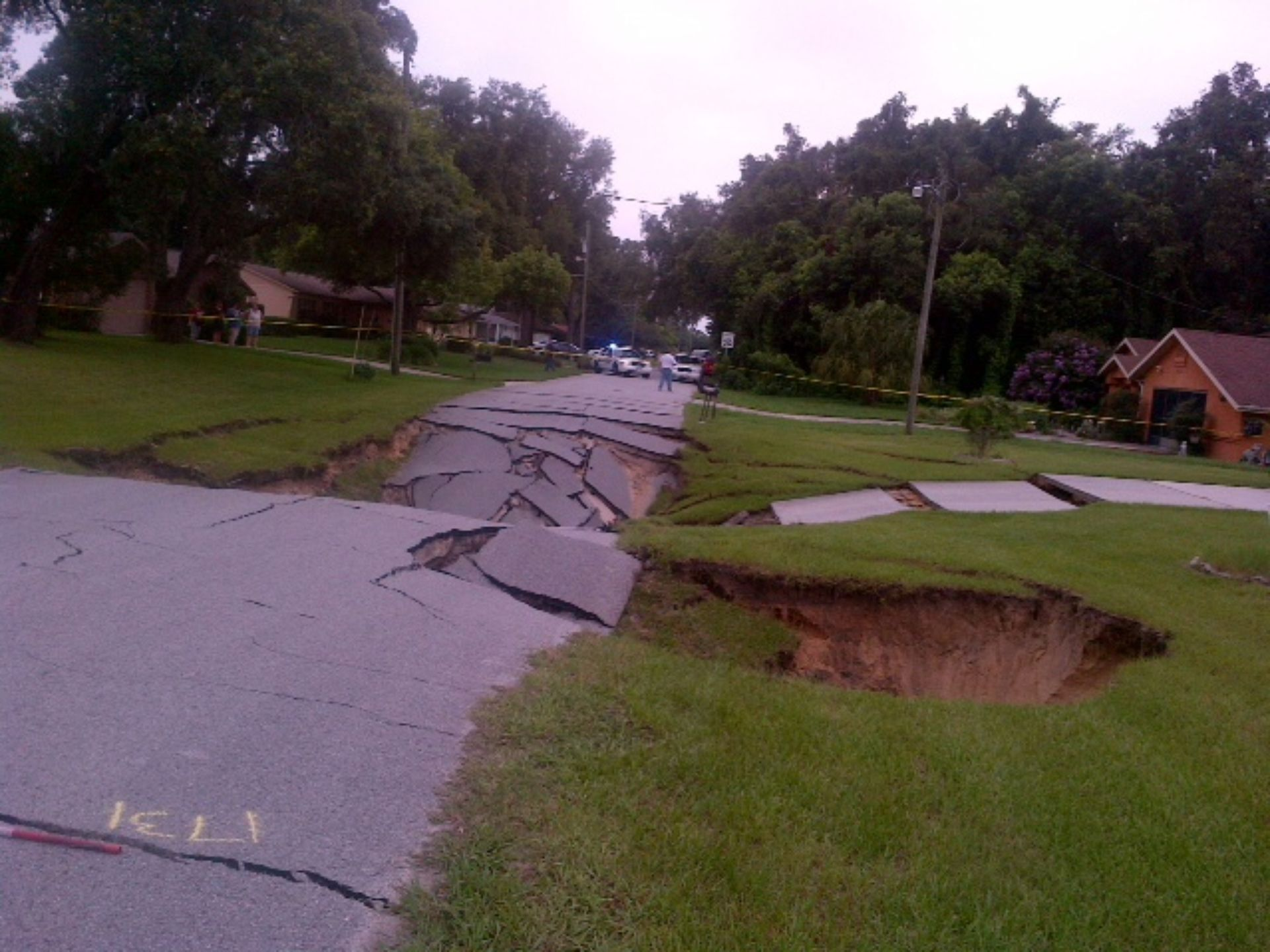 This monster sinkhole in Spring Hill, Florida measures now 40 x 40 yards long and is 30 feet deep. Amazing!, sinkhole, sinkhole formation, us sinkhole july 2014, florida sinkhole july 2014, spring hill giant sinkhole july 19 2014, giant sinkhole spring hill photo, photo of giant sinkhole in spring hill florida july 2014, video giant sinkhole spring hill july 2014, florida sinkhole florida july 2014, new sinkhole florida july 2014, sinkhole florida july 2014, giant sinkhole florida july 2014, giant sinkhole Spring Hill florida, Monster Sinkhole Swallows Roads In Spring Hill, Florida - July 19 2014, Terrifying Sinkhole Swallows Roads In Spring Hill, Florida - July 19 2014, This monster sinkhole in Spring Hill, Florida measures now 40 x 40 yards long and is 30 feet deep. Amazing!, sinkhole, sinkhole formation, us sinkhole july 2014, florida sinkhole july 2014, spring hill giant sinkhole july 19 2014, giant sinkhole spring hill photo, photo of giant sinkhole in spring hill florida july 2014, video giant sinkhole spring hill july 2014, florida sinkhole florida july 2014, new sinkhole florida july 2014, sinkhole florida july 2014, giant sinkhole florida july 2014, giant sinkhole Spring Hill florida, Monster sinkhole swallows road and cracks home in Spring Hill, Florida on July 19 2014. When will this sinkhole apocalypse end?