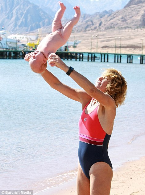 "Controversial: Lena Fokina shocking baby yoga. Photo: Youtube video, Controversial: Lena Fokina yogiing a baby on a beach during seminar called ""Parenting the Deliberate Way"" in Dahab, Egypt. Photo: Youtube video, Lena Fokina shocking baby yoga: Baby and child abuse. GIF: RT Video, baby yoga, shocking baby yoga, controversial baby yoga, baby yoga gif, Lena Fokina shocking baby yoga, Lena Fokina baby yoga gif, Lena Fokina baby yoga youtube, Lena Fokina shocking baby yoga youtube video, yoga, baby yoga, shocking baby yoga, lena fokina, russian yoga guru, incredible things"
