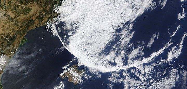 This strange arc-shaped cloud band was photographed by MODIS over the Mediterranean on August 13, 2014, strange weather phenomena, arc-shaped cloud band, arc-sshaped cloud band spotted over Mediterranean, strange weather phenomenon, strange cloud formation, weird cloud phenomenon