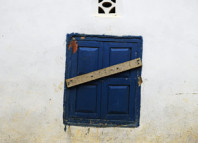 ebola, ebola gravediggers, ebola outbreak, disease outbreak, ebola 2014, ebola west africa 2014, A barricaded window on a house under quarantine. Credit Samuel Aranda for The New York Times