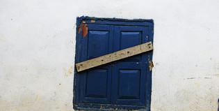 ebola, ebola gravediggers, ebola outbreak, disease outbreak, ebola 2014, ebola west africa 2014, A barricaded window on a house under quarantine. Credit Samuel Aranda for The New York Times