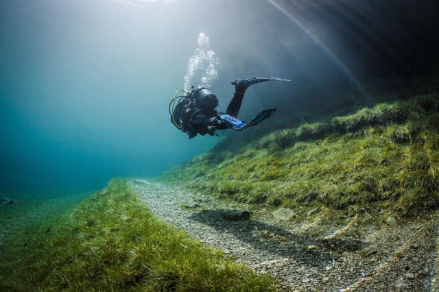 Mystery Places On Earth: Discover The Underwater Park At Grüner See (Green Lake) , Grüner See, Gruener See, Green Lake, Grüner See photo, Grüner See video, underwater park at grüner see, submerged park at grüner see, dive at Green lake, discover underwater park at Grüner see, green lake underwater park, You do not expect what you will discover under the Grüner See! A submerged park, From April to July, the Tragöß park is submerged by the Grüner See (Green Lake) in Austria, In and out. The park in Tragöss becomes underwater as melt waters engulf the Green Lake, Follow the path: Walkable during winter, the path is only swimable in summer time at Green Lake.