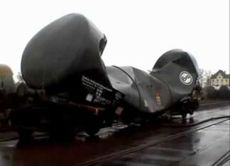 vacuum implosion of railroad tank car, railroad tank car vacuum implosion, railroad tank car implosion, implosion of railroad tank car, This is the result of a railroad tank car implosion: A crunched wagon! Amazing. Photo: Youtube video