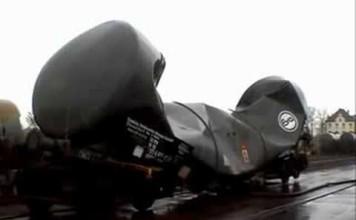 vacuum implosion of railroad tank car, railroad tank car vacuum implosion, railroad tank car implosion, implosion of railroad tank car, This is the result of a railroad tank car implosion: A crunched wagon! Amazing. Photo: Youtube video