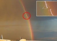 lightning airplaine rainbow photo, nature phenomena photo, best nature photo, best plane photo, lightning rainbow plane photo, This is one of the best nature shot ever: Lightning strikes plane in front of a rainbow!, Perfect Timing! Amazing photo shows a lightning striking a plane in front of a rainbow! WOW!