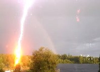 lightning, lightning video, best lightning video, amazing lightning video, terrfying lightning video, awesome lightning video, Flash? Lightning Almost Strikes Woman Filming A Rainbow in Sweden (VIDEO)