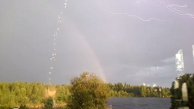 lightning, amazing lightning, after lightning, Flash? Lightning Almost Strikes Woman Filming A Rainbow in Sweden (VIDEO), Double raibow, sky lightining and remains of bolt that hit the ground in Sweden