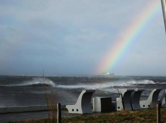 Raibow and raging sea during wind storm in Punta Arenas on August 8 2014. Photo: Facebook, punta arenas rainbow winds august 2014, punta arenas wind storm,