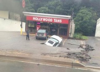 OMG! My car is being swallowed by a sinkhole at Ross Township. Photo: Twitter, Ross Township sinkhole, ross sinkhole, sinkhole swallows car Ross Township, sinkhole car Ross Township, car swallowed by sinkhole in Ross Township pa, ross sinkhole swallows car august 2014, sinkhole car ross township august 2014, The car is being swallowed by a huge sinkhole in Ross Township, Pa on August 12 2014.