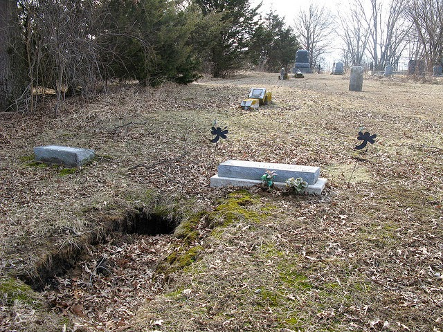 The sould of this body has escaped that sunken grave in Missouri, Cave-ins under sinkhole in Gravesend. A portal to another world?, sunken graves, sinkhole under graves, sinkhole grave, grave sinkhole, sunken graves mexico, The sould of this body has escaped that sunken grave in Missouri, Cave-ins under sinkhole in Gravesend. A portal to another world?, This Dunedin cemetery looks creepy with its sunken graves