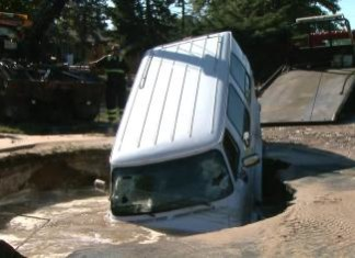 sinkhole, sinkhole denver, denver sinkhole, sinkhole denver september 2014, This parked van was swallowed by a sinkhole in Denver. Photo: CBS