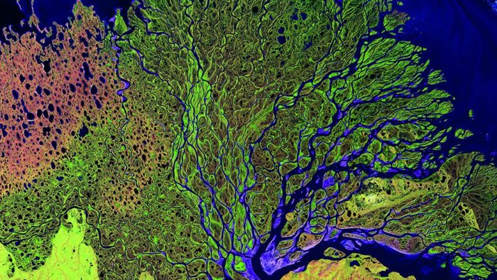 , earth from space, earth from space photo, satellite images from earth, best earth from space photoThis image captures Russia's Lena River, one of the longest in the world at 2,734 miles. Green represents vegetation, pink represents sand and blue-mauve is water. (NASA/GSFC/USGS EROS Data Center)
