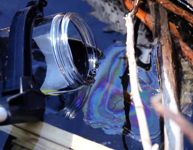 The Mount Polley Mine Disaster Has Produced a Mysterious, Waxy Blue Substance video, video of mysterious blue and waxy substance on lake quesnel in BC, mysterious blue film on quesnel lake BC, unknown substance bc, unexplained blue substance on lake quesnel bc, What is this mysterious blue substance that appeared floating on Lake Quesnel, BC, just after the Mount Polley mine disaster. Photo from youtube video, Mount Polley mine disaster video, results of Mount Polley mine disaster video, mystery, strange, blue substance, unknown, weird, video