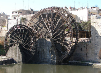 noria, groaning noria in syria, noria hama, The norias of Hama on the Orontes River in Syria ar producing strange groaning sounds, Groaning Norias Syria, Groaning Noria at Hama, sound tourism, sonic wonder, sounding places, strange sounding architecture