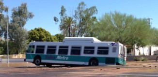 sinkhole bus tempe arizona, sinkhole tempe, sinkhole swallows but is tempe arizona, arizona sinkhole tempe, tempe arizona sinkhole, A bus was trapped by in a sinkhole in Tempe, Arizona on September 3 2014. Photo: Jesse A. Millard