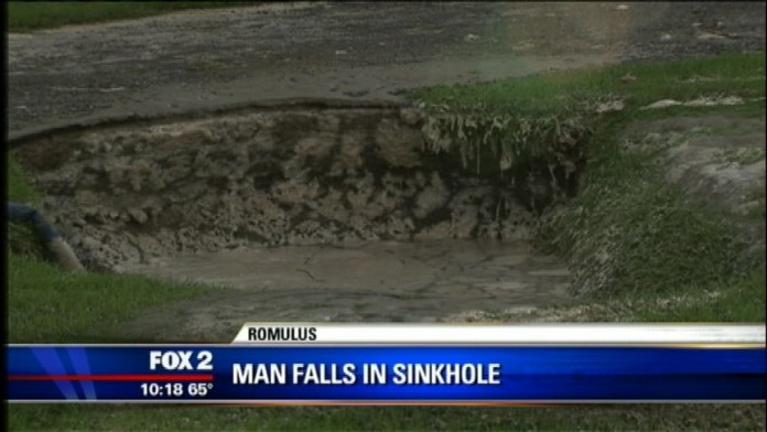 sinkhole romulus, sinkhole romulus photo, sinkhole romulus video, sinkhole swallows man in romulus video, detroit sinkhole swallows man, sinkhole romulus detroit swallows man, sinkhole romulus september 2014, sinkhole romulus kills man, sinkhole romulus michigan, This sinkhole swallowed and almost killed a man in Romulus, Michigan. Photo: Foy News Video