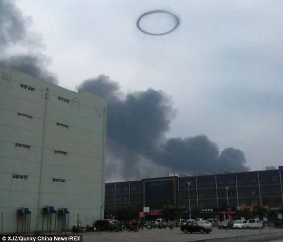 smoke rings, smoke of rings china sky, smoke ring, smoke rings explosion photo, smoke rings explosion china photo, smoke rings explosion china, Eerie smoke rings were created by a fireball explosion at a fibreglass factory in China on September 9, 2014, Particularly flammable resins triggered these weird rings of smoke in the sky, The fire and explosion remain unexplained. However the air in the area was heavily polluted, Pretty strange phenomenon, isn't it?, smoke rings, smoke rings china, explosion, fireball explosion, fibreglass factory explosion, explosion china, pollution china, photo