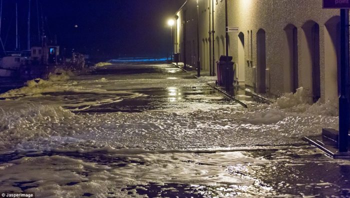 Sea foam forms when during stormy weather in coastal areas, Sea foam, Sea foam news, Sea foam moray, Sea foam britain, Sea foam october 2014, Sea foam covers streets in in Lossiemouth, Moray, Foamy surface water in the streets of Lossiemouth, Moray blocked roads and traffic.