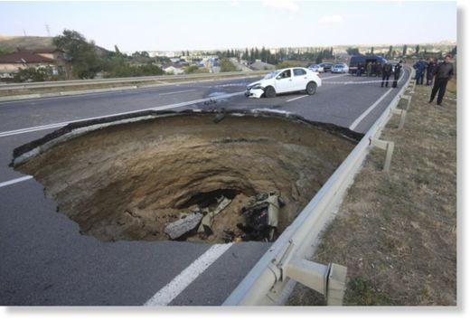 sinkhole, sinkhole crimea, sinkhole car crimea, giant sinkhole swallows car crimea, crimea sinkhole swallows car, sinkhole swallows car in Crimea and kills an entire family in Ukraine.