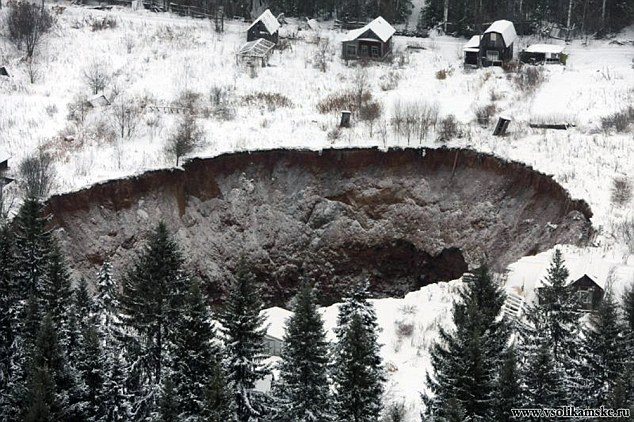 Giant 130ft Sinkhole Opens Up Near Russian Potash Mine After Flooding, Russian Potash Giant Uralkali sinkhole, sinkhole appears at Russian Potash Giant Uralkali, giant sinkhole potash mine nov 2014, potash mine sinkhole news, potash mine sinkhole russia photo nov 2014, Did it swallow worker houses?
