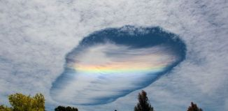 fallstreak hole photo victoria november 2014, punch hole cloud victoria november 2014, mysterious cloud over victoria australia, punch hole cloud and fire rainbow clouds victoria november 3 2014, alien fallstreak cloud victoria picture, Mysterious punch hole and fire rainbow clouds in the sky over Victoria, Australia on November 3 2014. Photo: David Barton, strange clouds, strange clouds photo fallstreak hole nov 2014