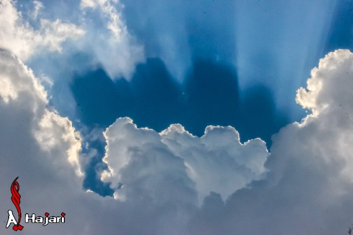rays and double clouds shadow, double cloud shadow, strange cloud formation, strange clouds, Are these rays and double cloud shadows photographed over Isa Town, Kingdom of Bahrain signs of apocalypse? Photo: Ali Majeed Al-Hajari