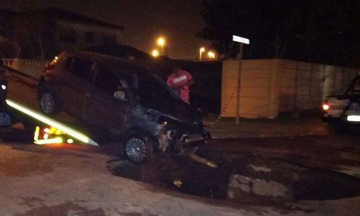 car swallowed by sinkhole in Cape town november 1 2014, sinkhole cape town november 2014, sinkhole swallows car cape town, sinkhole swallows car cape town photo, sinkhole car cape town november 2014, sinkhole cape town swallows car november 1 2014
