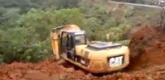 surfing backhoe video, excavator surfs landslide, backhoe landslide video, backhoe surfs landslide video, landslide excavator surfing, surfing a landslide, extreme: backhoe surfs a landslide video