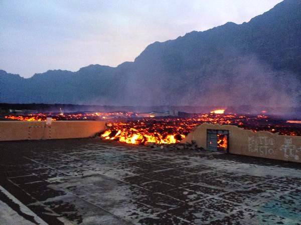 FOGO VOLCANO eruption december 2014, fogo volcano video, fogo volcano pictures, fogo volcano river of lava destroys two villages, A raging river of lava has engulfed two villages sitting near the Fogo volcano in the Cape Verde Islands.